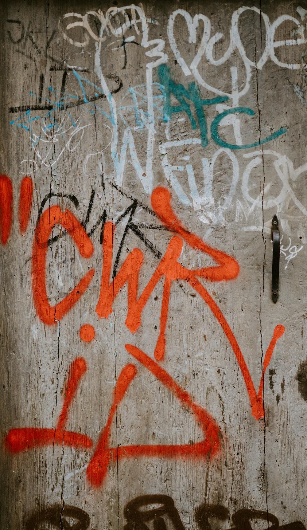 white and orange graffiti wall
