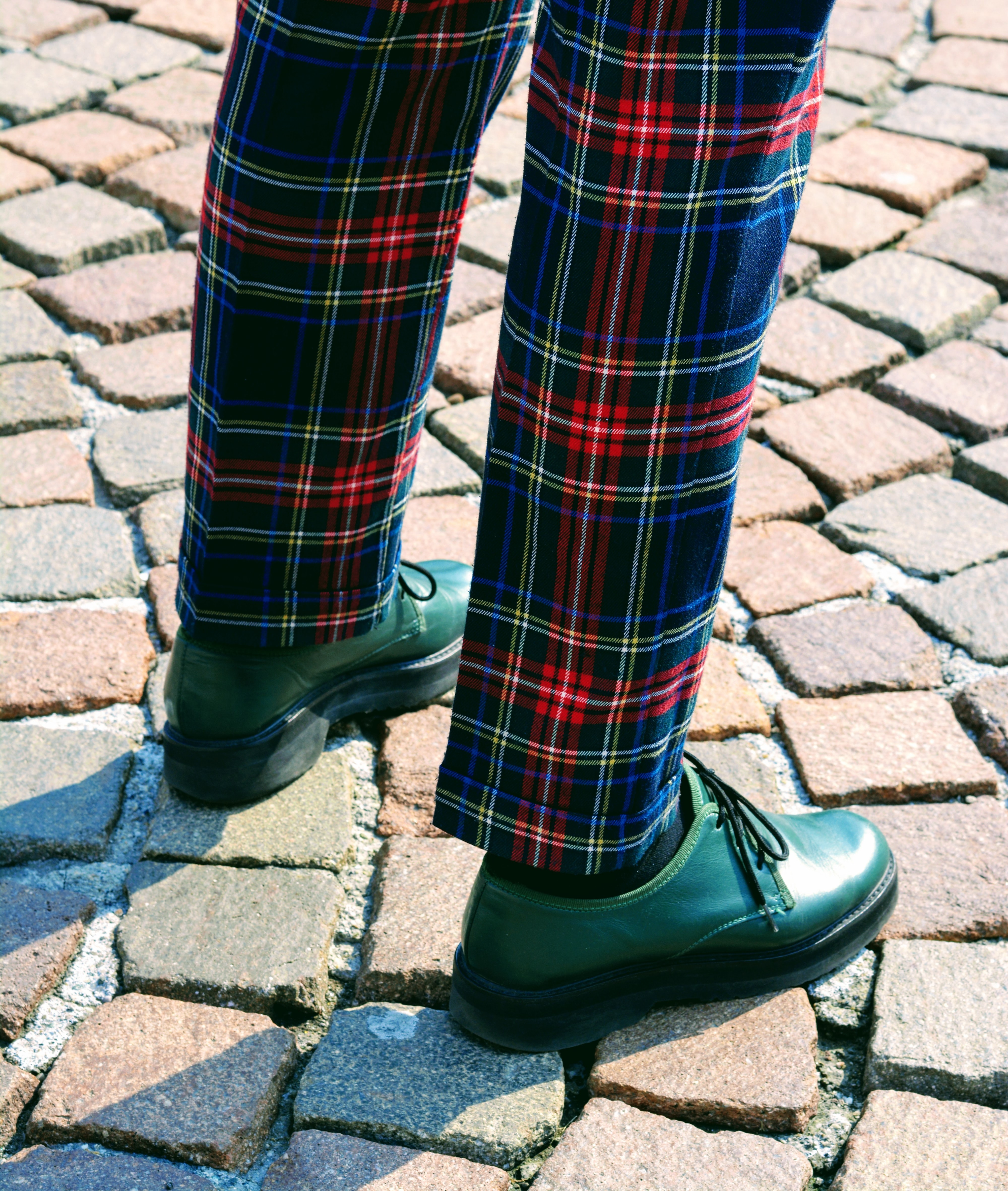 person wearing blue, red, and gray plaid pants