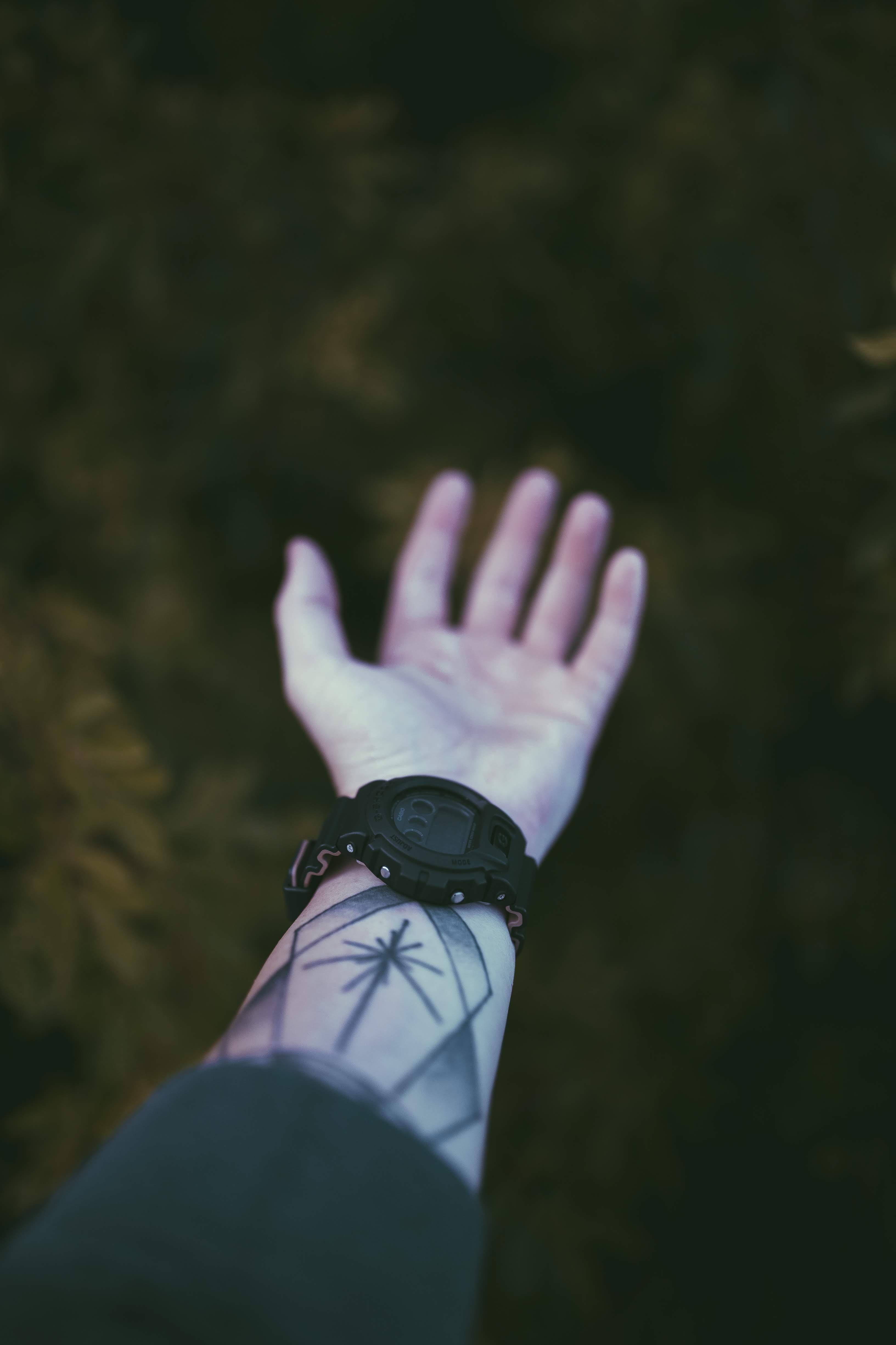 person wearing round black digital watch