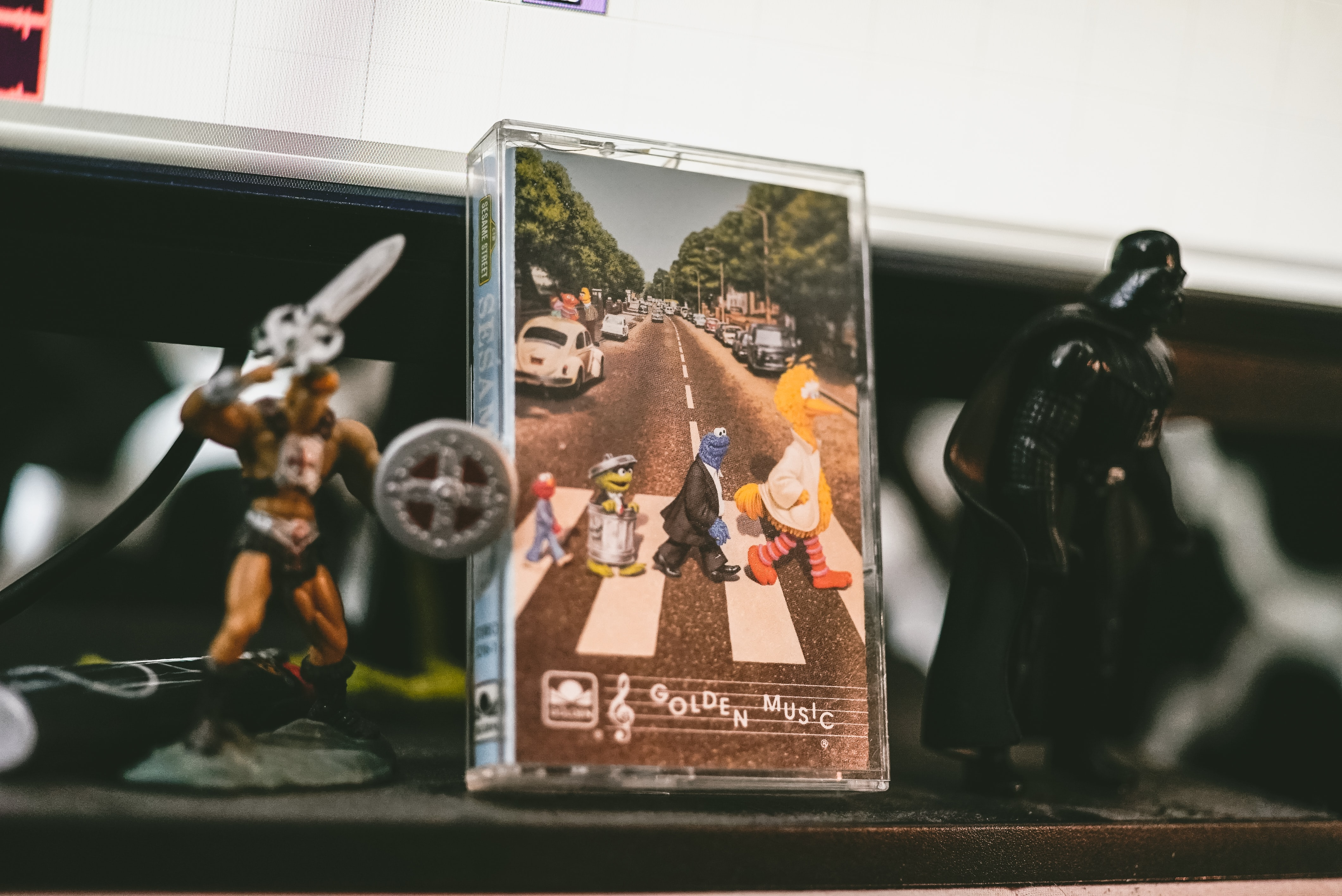 two He-Man and Darth Vader figurines on table