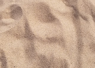 focus photo of brown sand