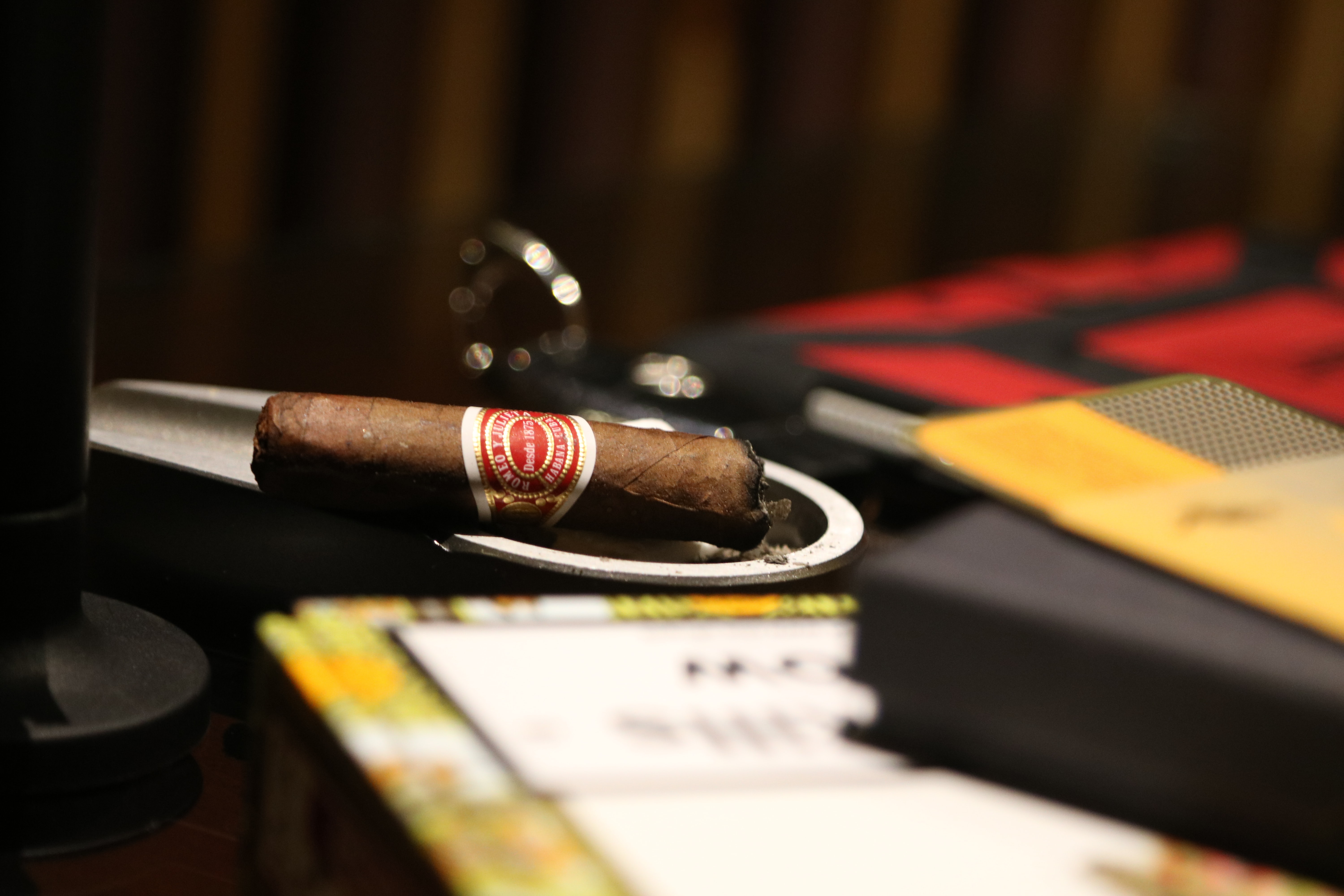selective focus photography of brown cigar on table