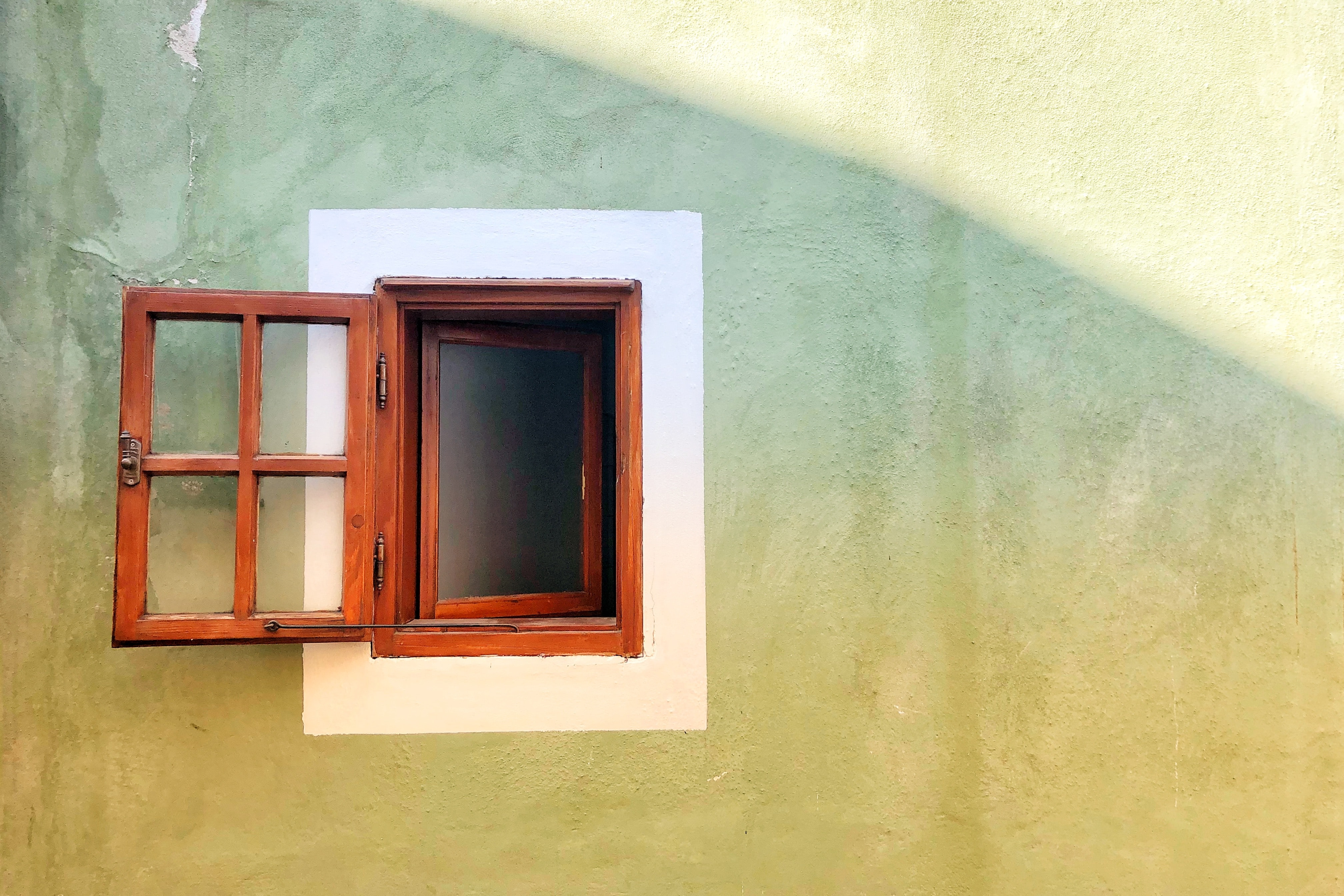 opened brown wooden window