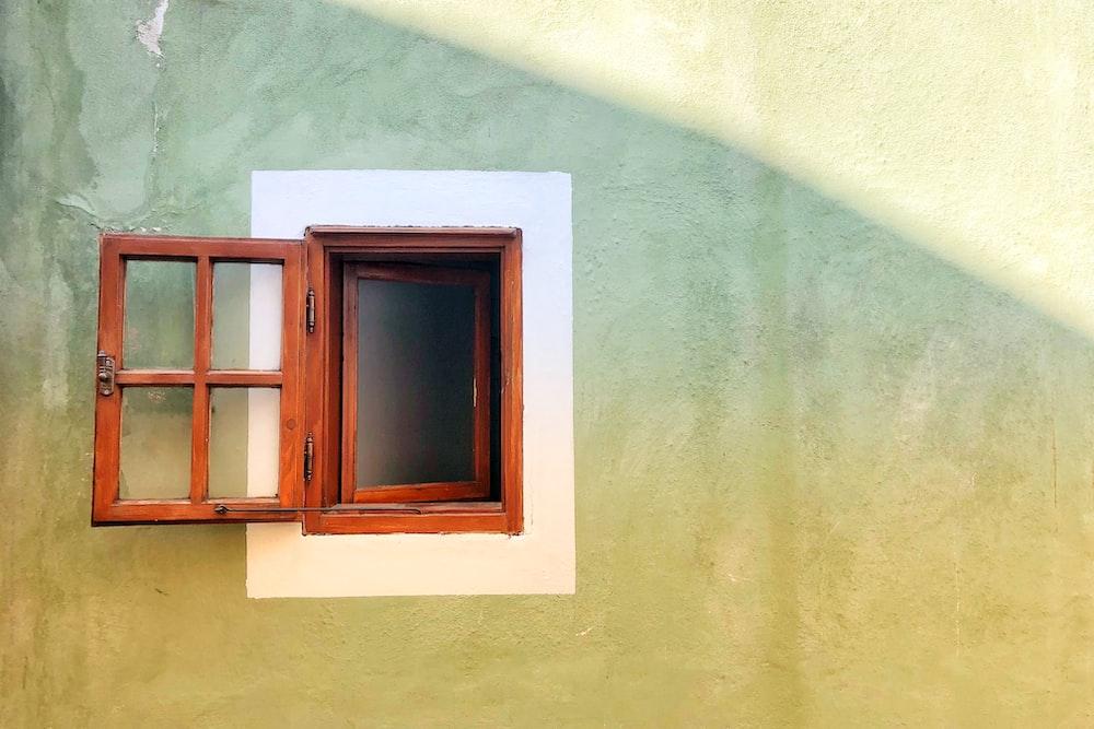 opened brown wooden window