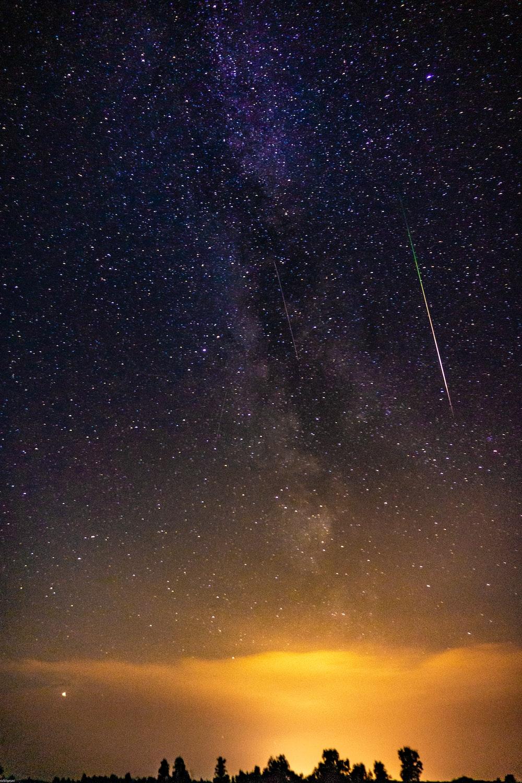 landscape photo of meteor shower