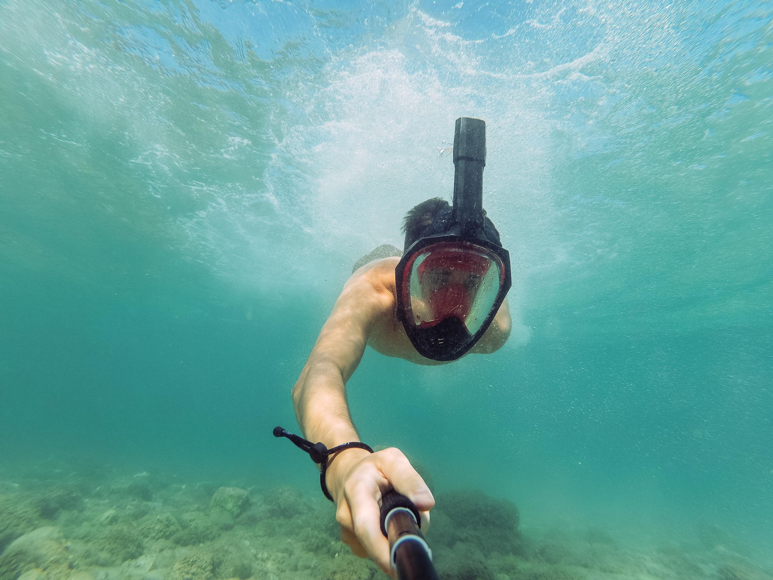 man taking selfie under water