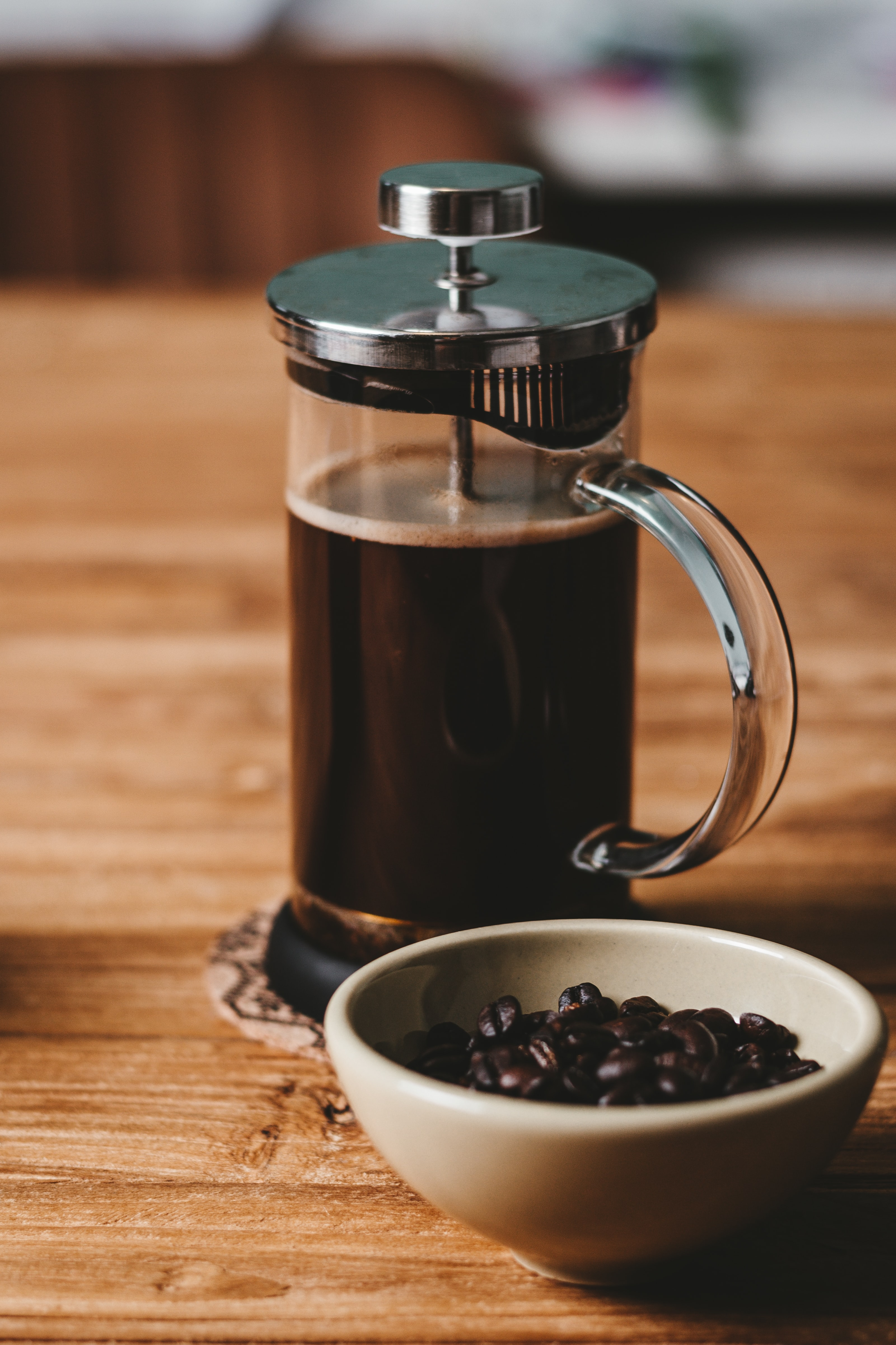 clear glass French press filled with milk