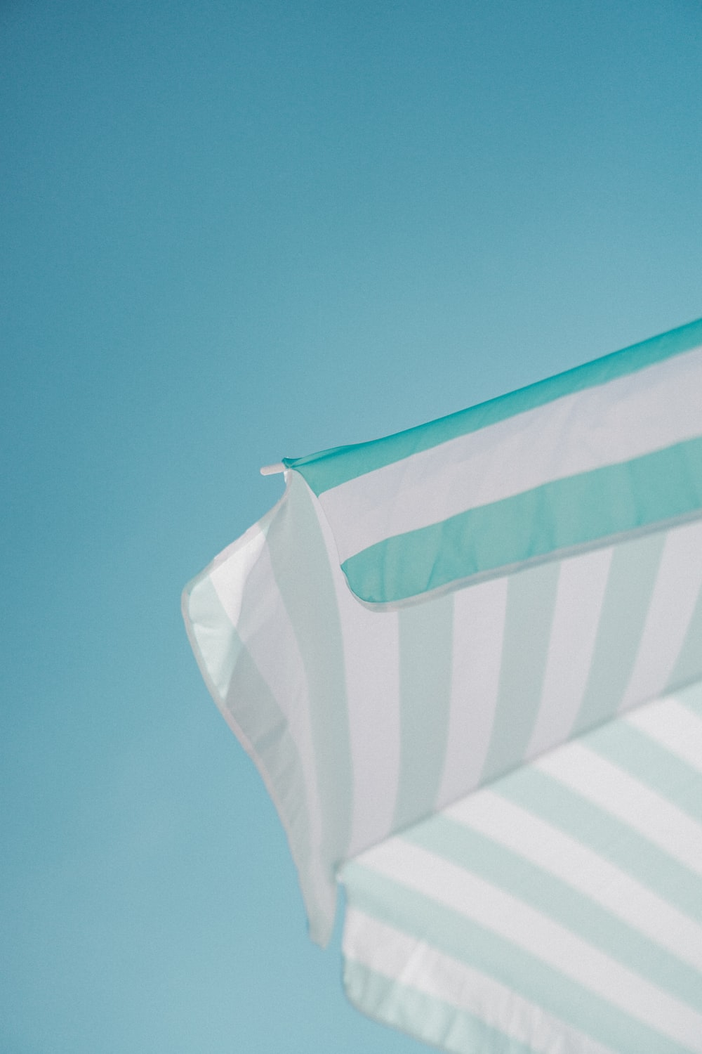 white and green striped parasol during daytime photo