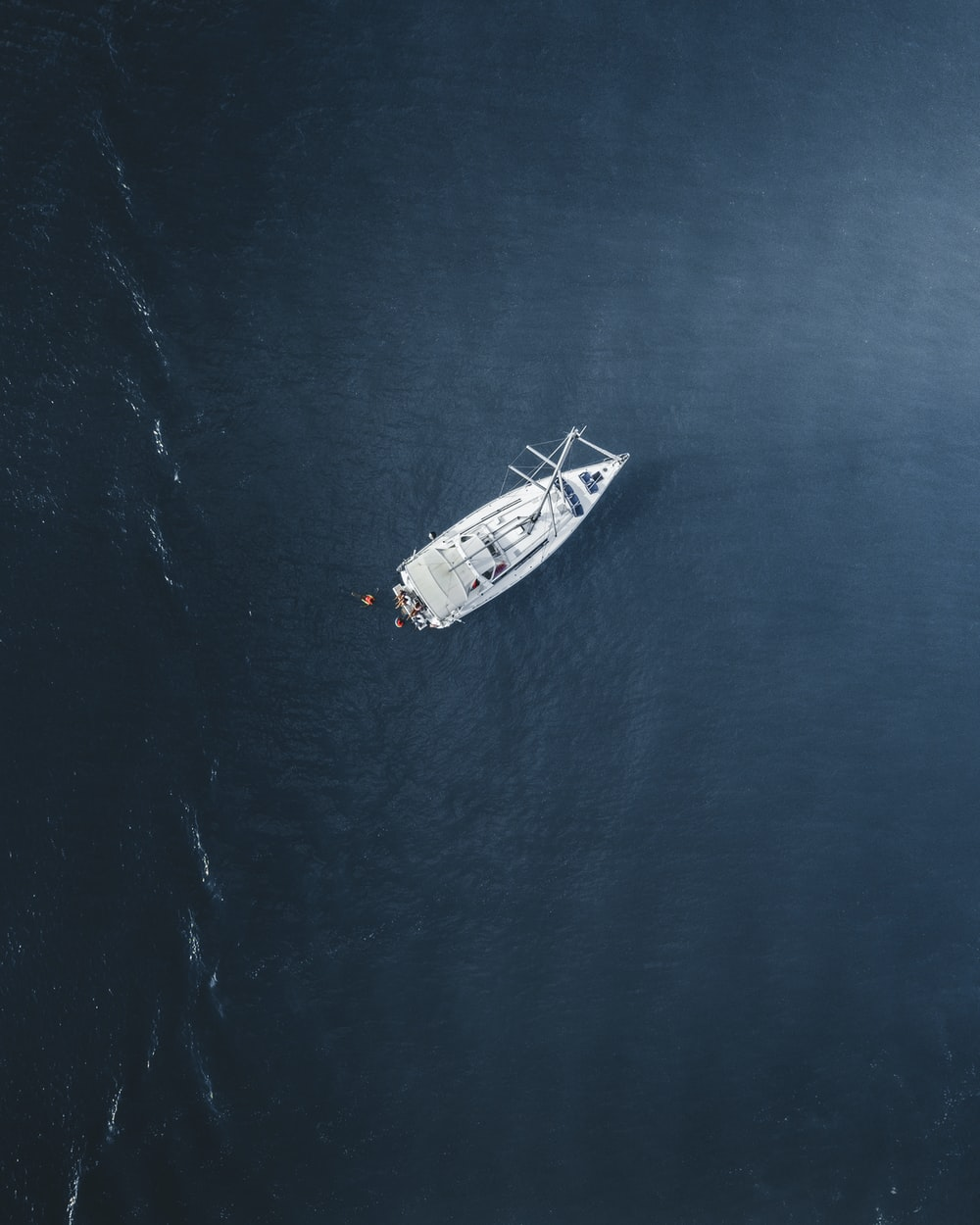 aerial photography of white yacht sailing on water at daytime