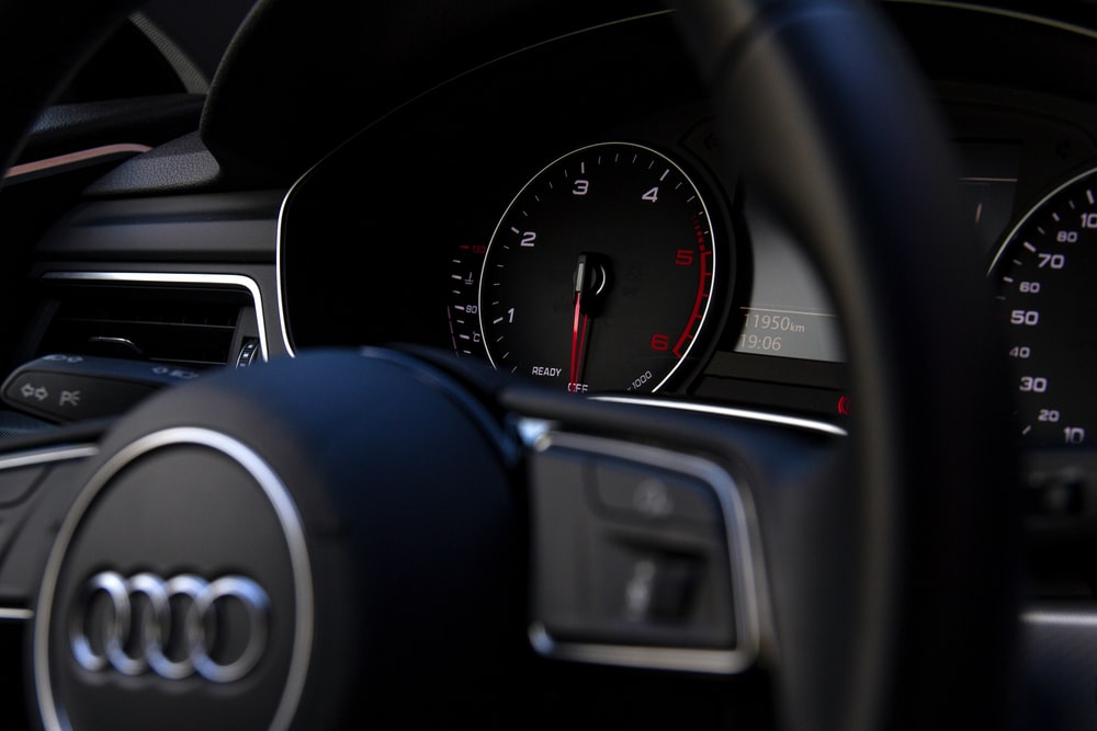 black Audi vehicle steering wheel