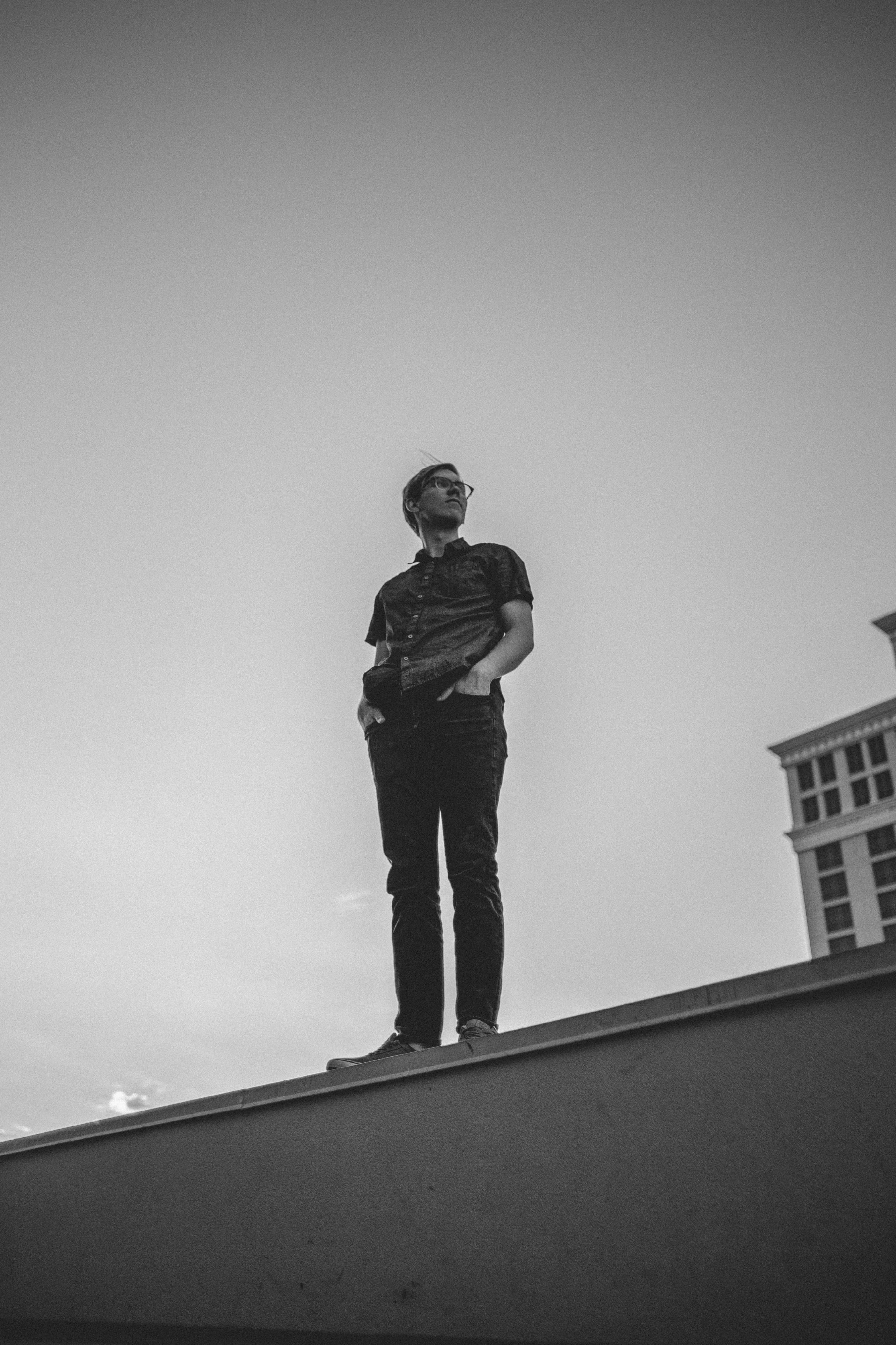 man standing on building edge