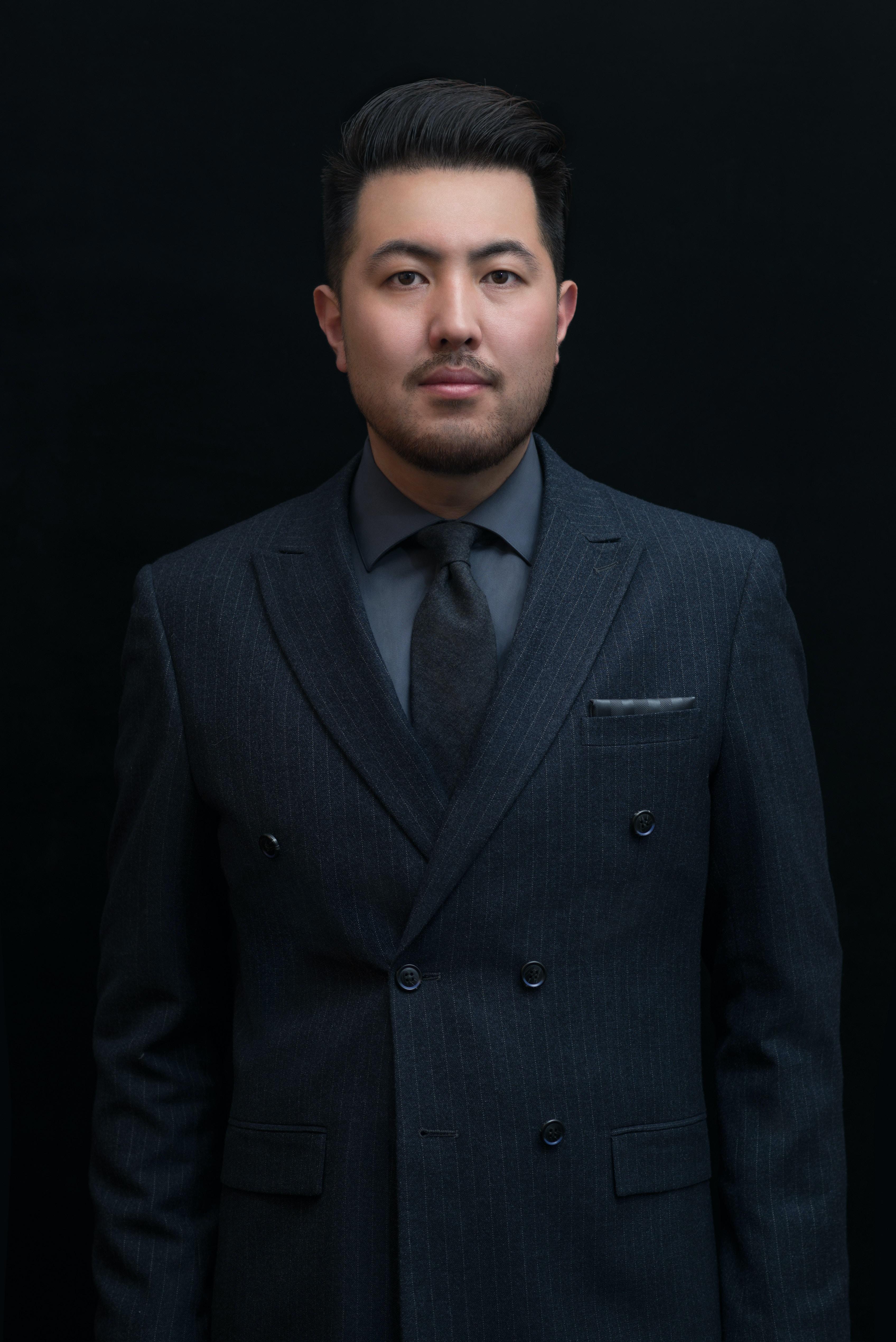 man in black formal suit jacket