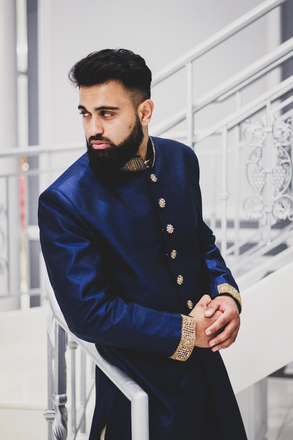 man wearing blue thobe suit