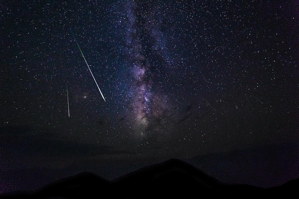 falling stars and milky way galaxy at night