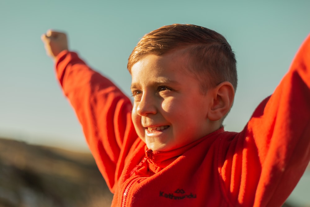 boy with red jacket