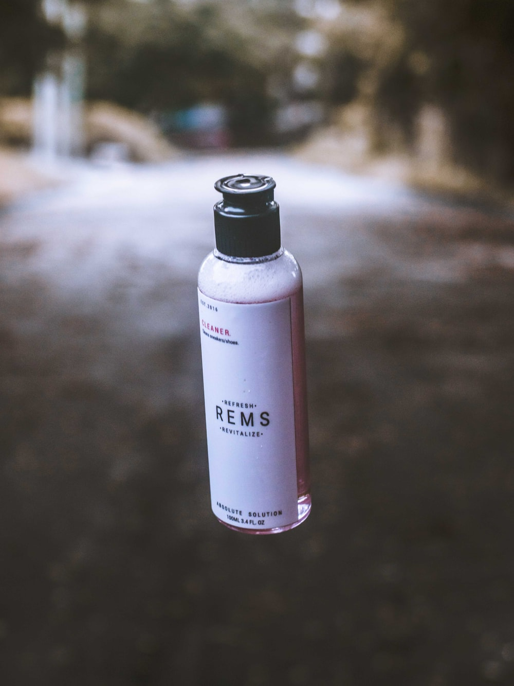 white and black Rems bottle floating