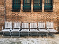 six white steel chairs