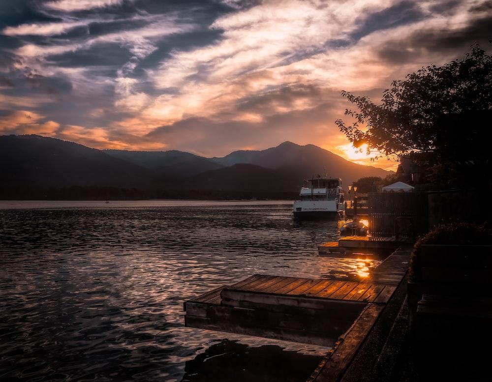 boat on body of water near mountain