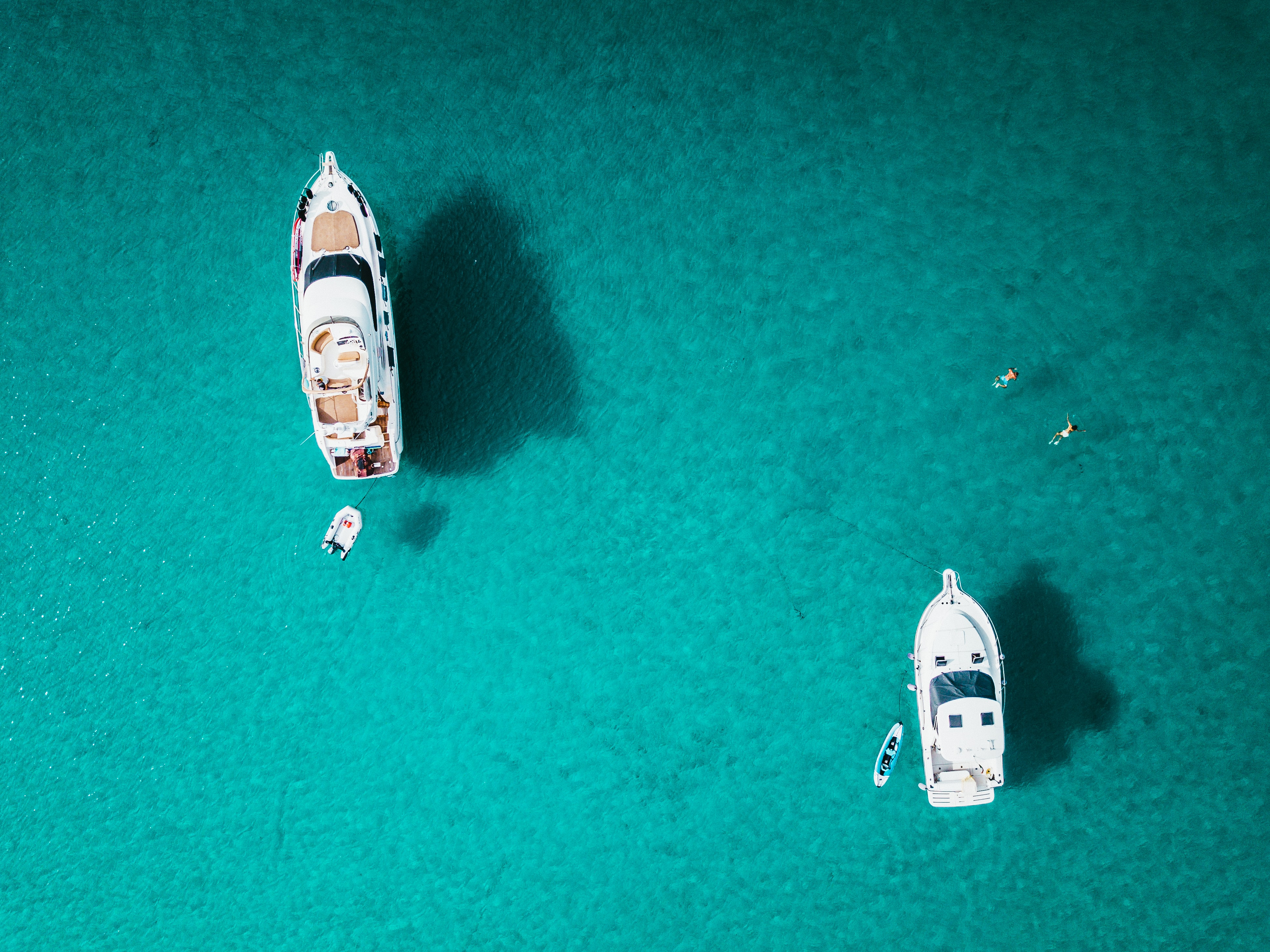 top view of two white yachts