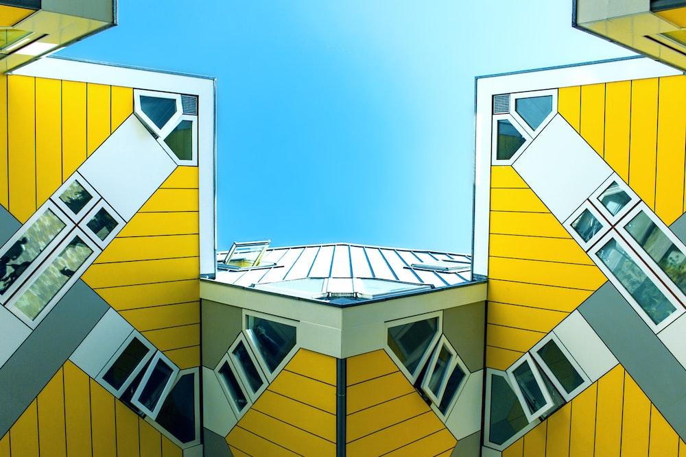 yellow painted building digital wallpaper