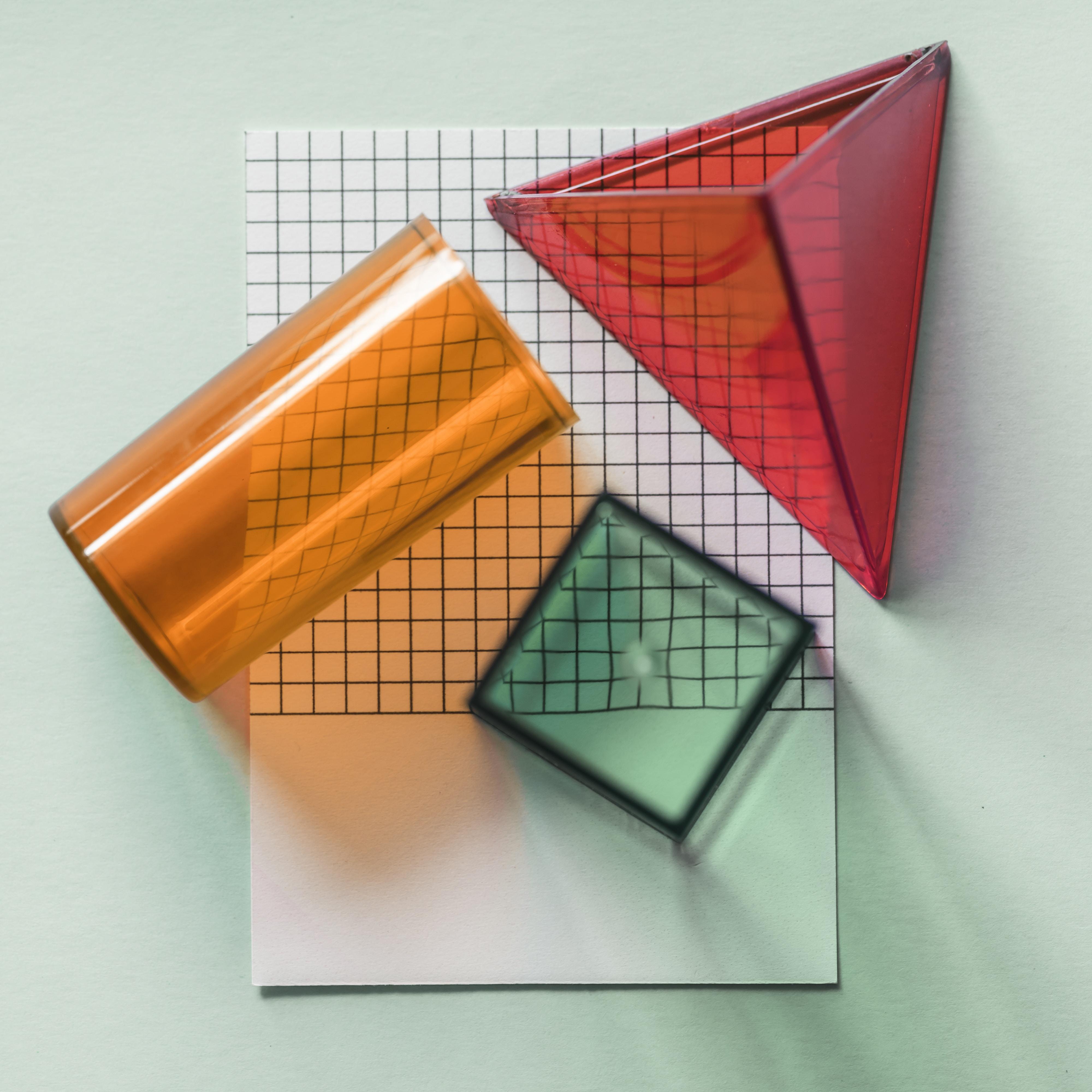 three red, green, and orange geometric shape artwork