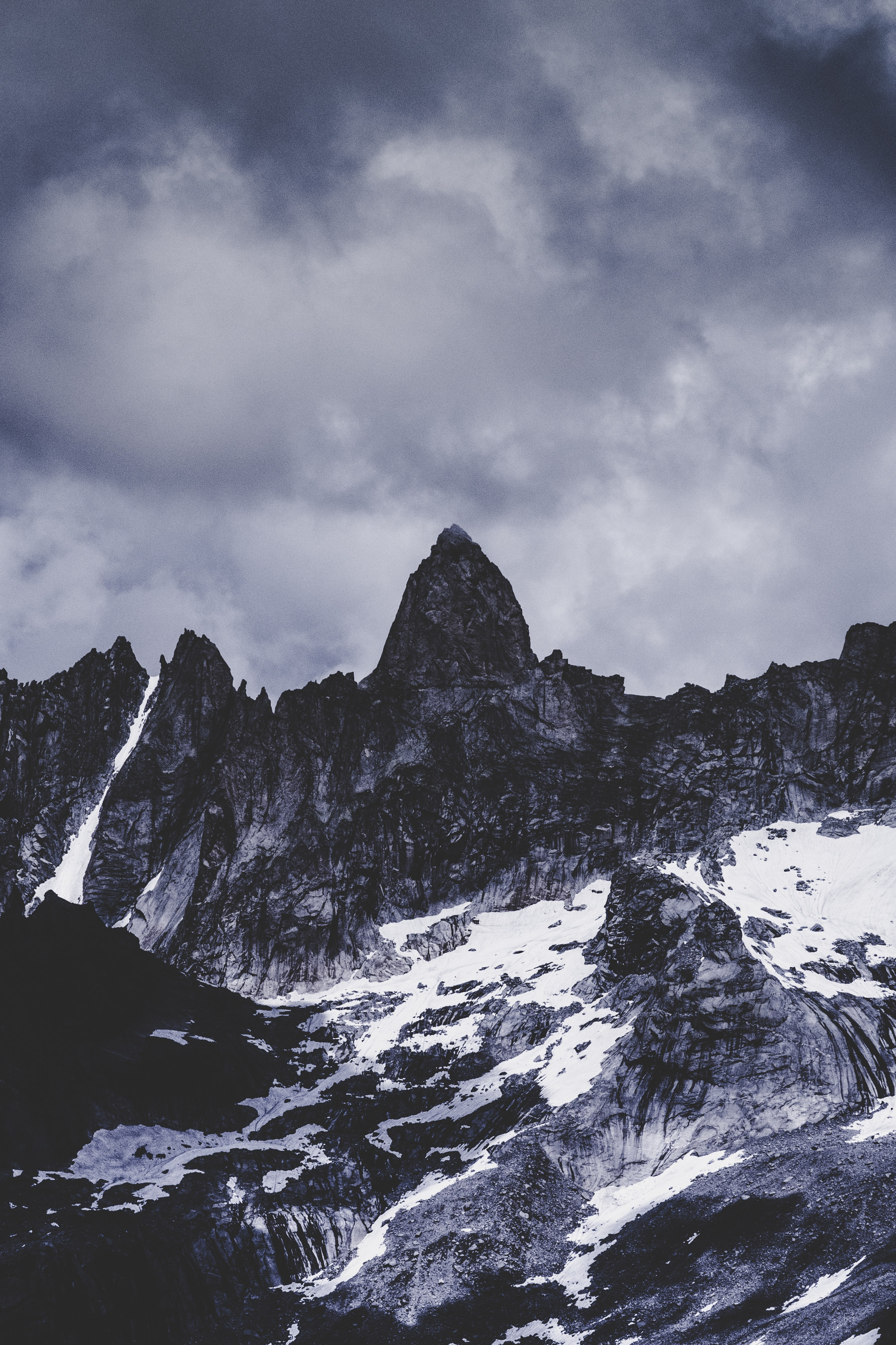 grayscale landscape photography of mountain under alto cumulus clouds
