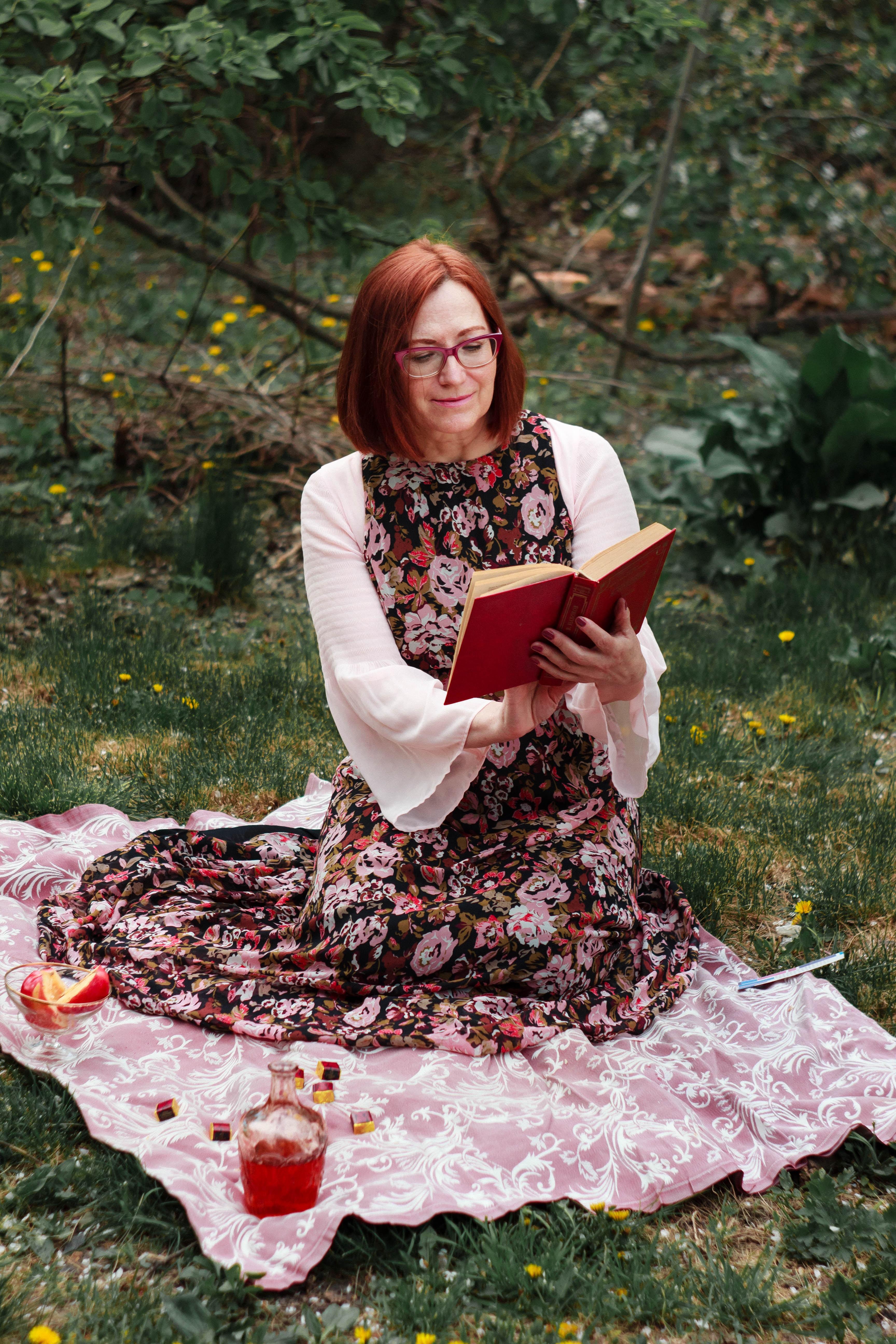 woman kneeling on floral mat on park