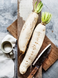 two white radish vegetable and knife
