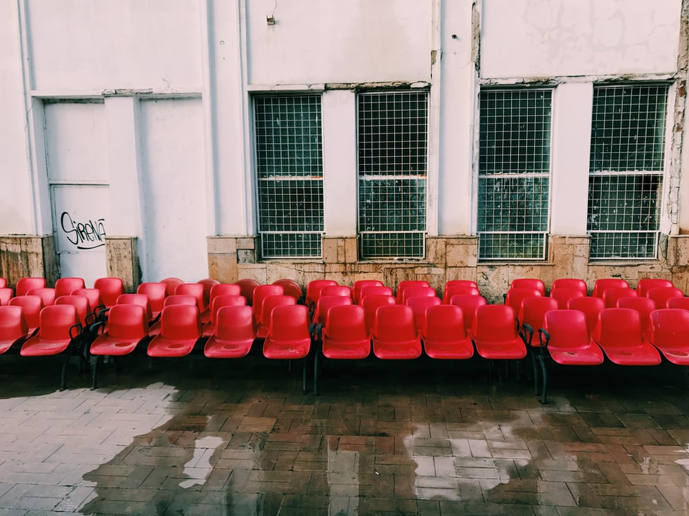 red and black plastic chair lot