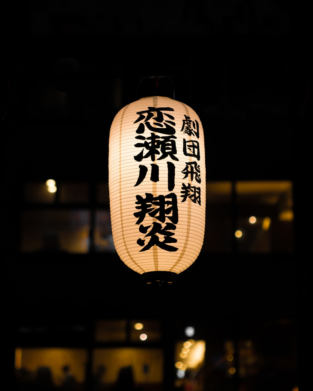 turned-on pendant lamp with non-English text