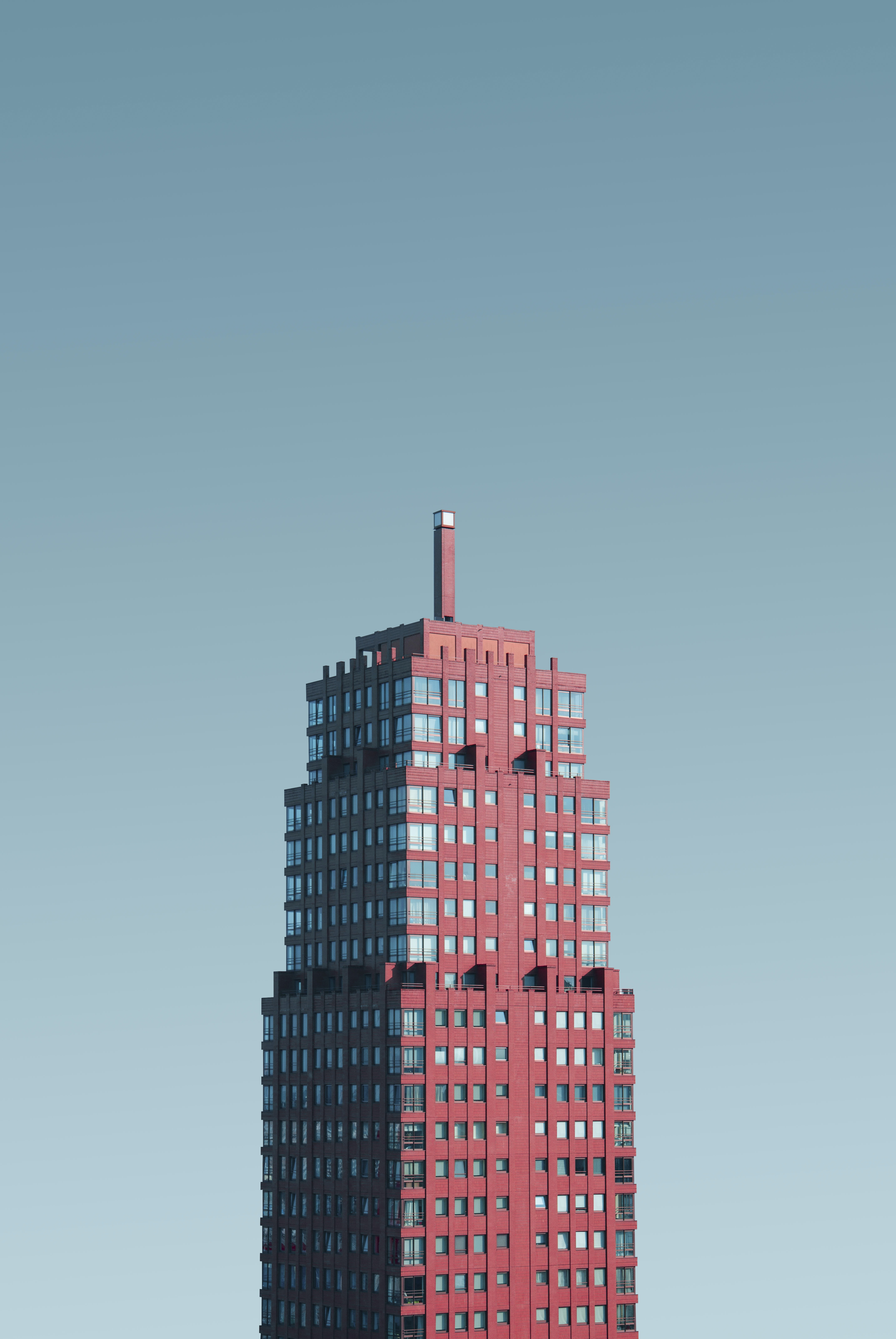 aerial photography of red and glass building