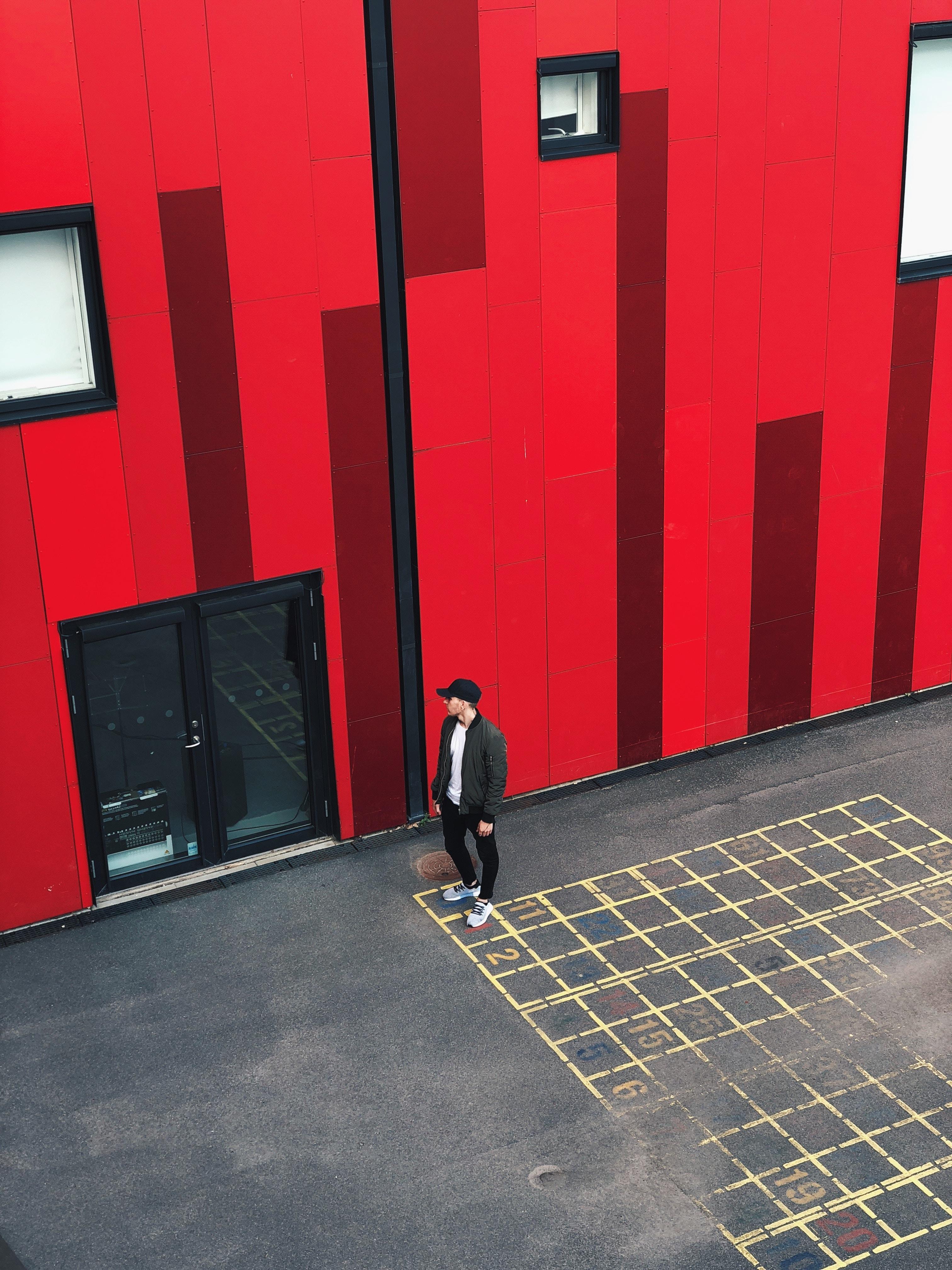 man standing near full-glass door
