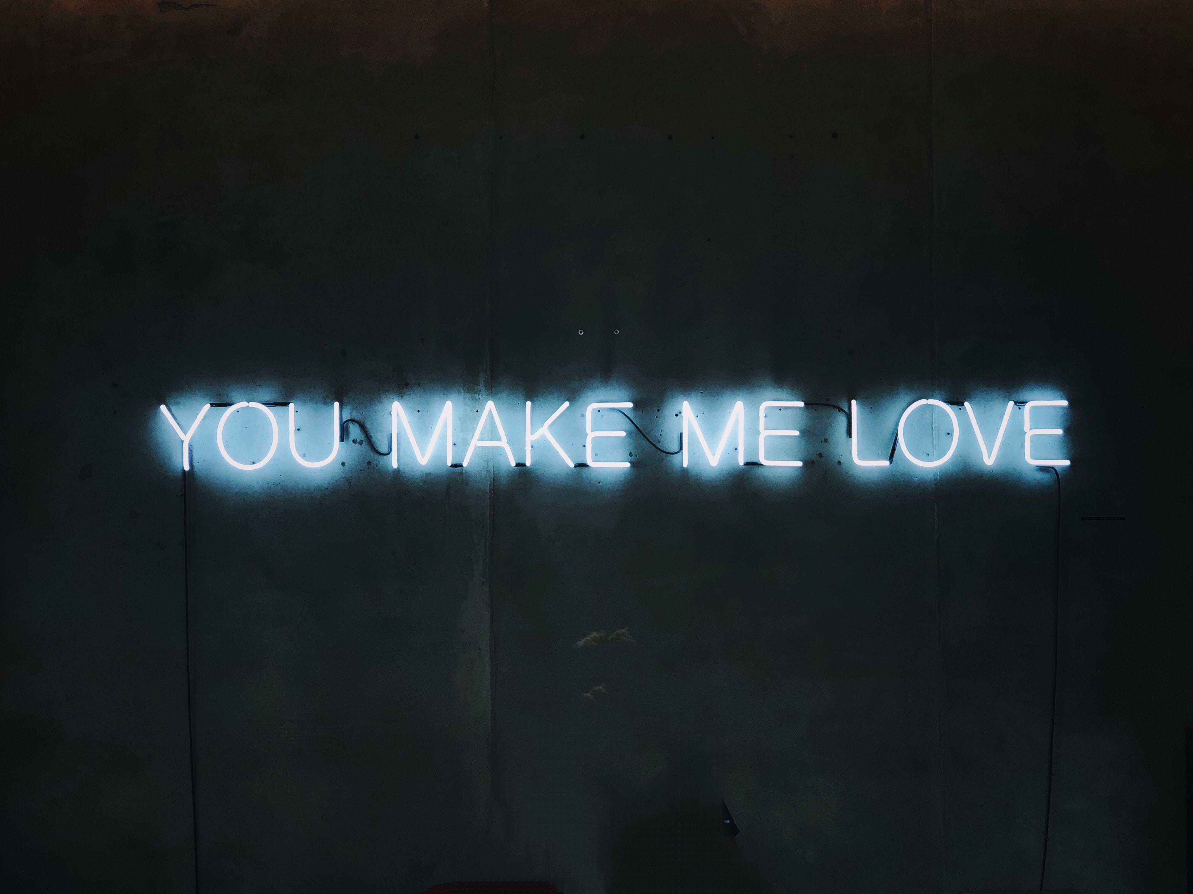 blue You Make Me Love neon light signage turned-on