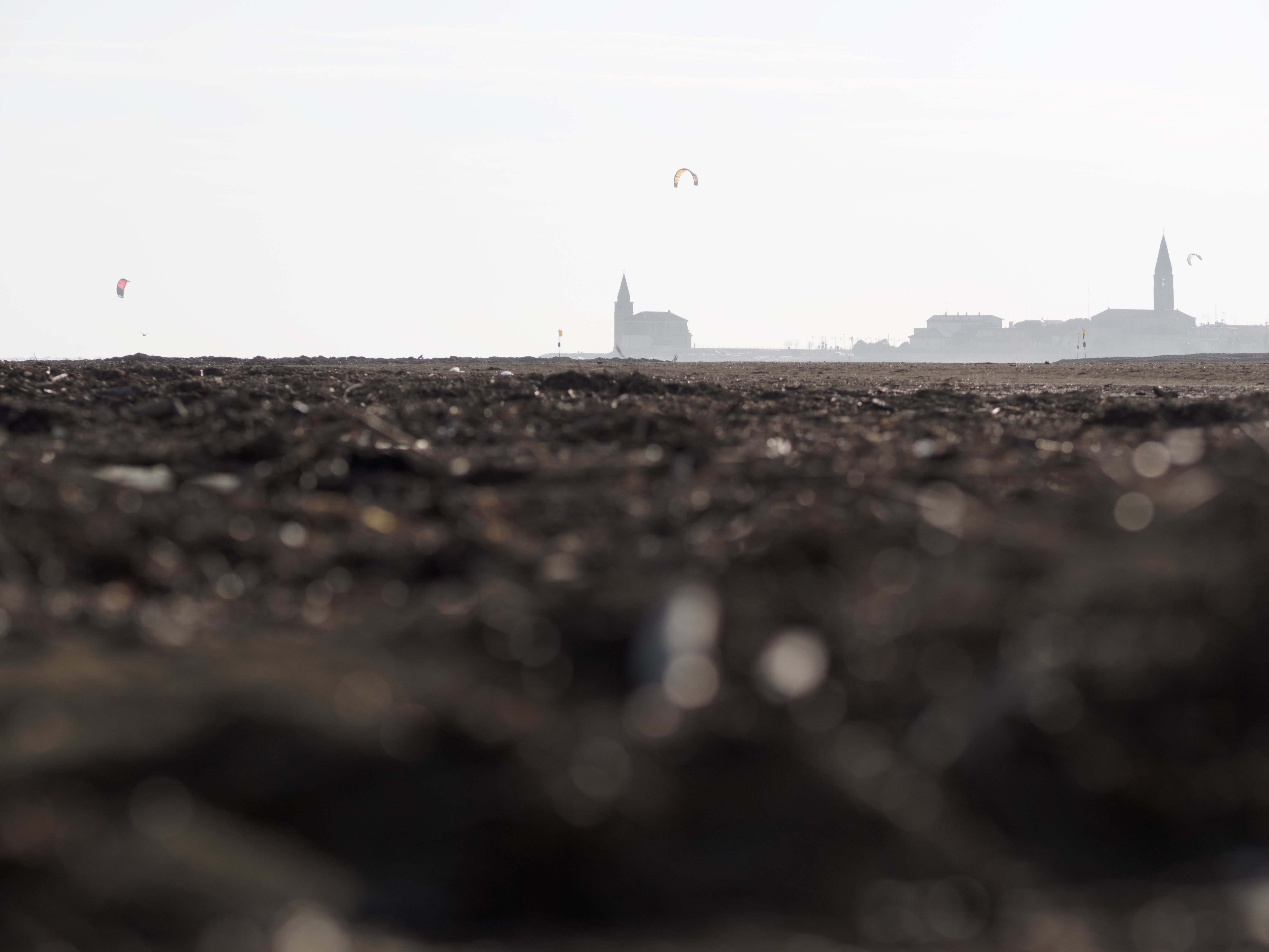selective focus photo of brown sand across buildings