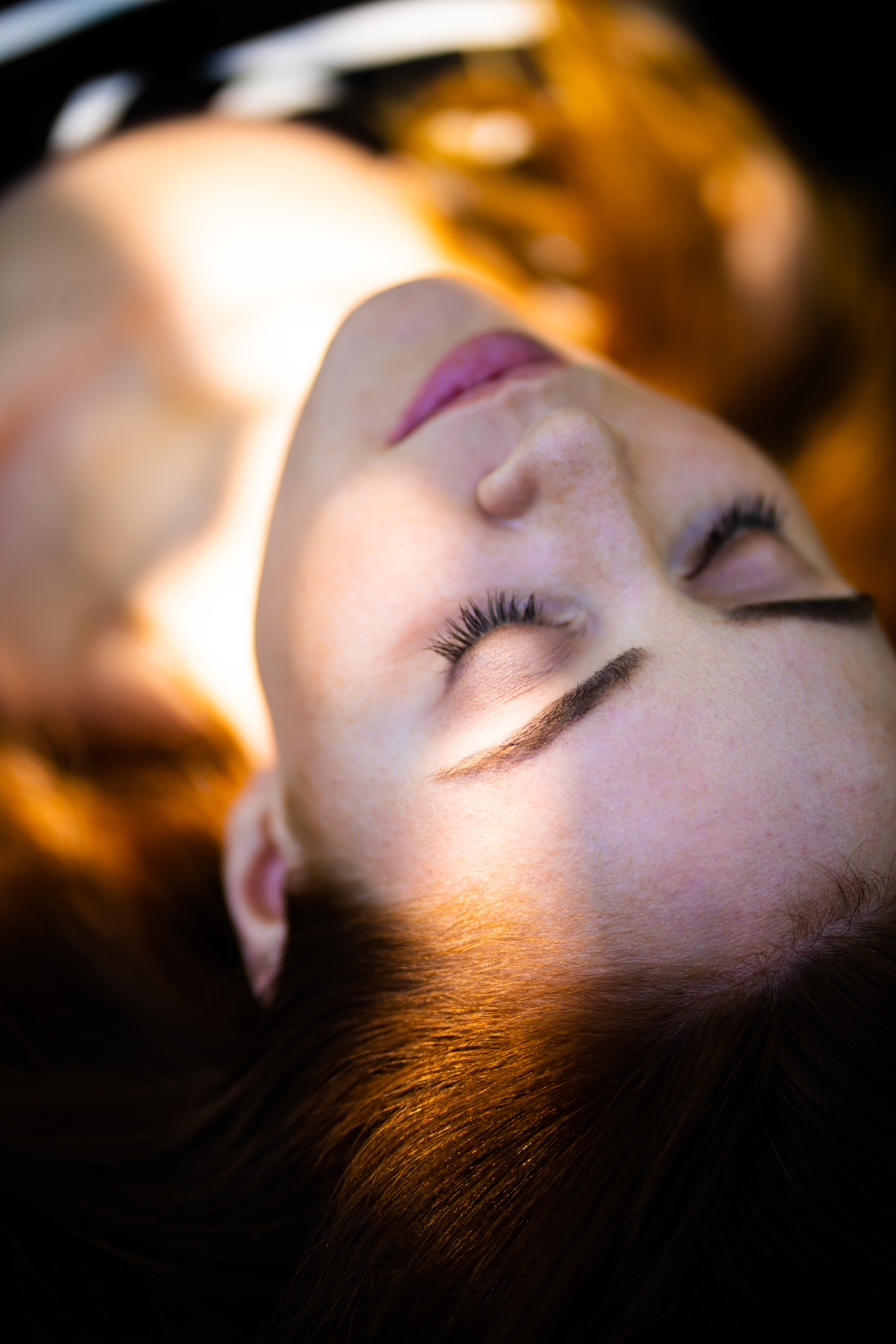 selective focus photography of sleeping woman at daytime