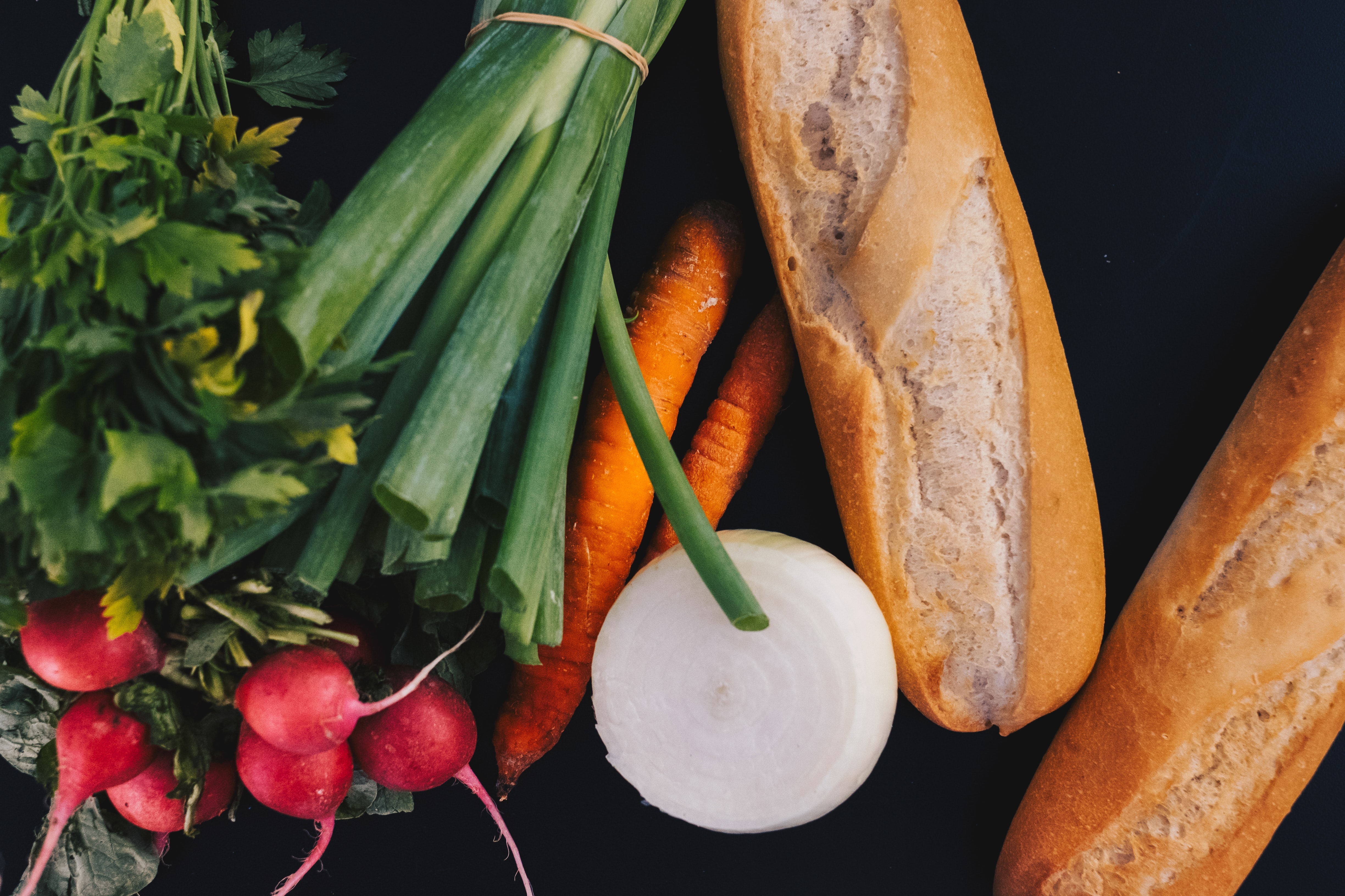 French bread, carrots, spring onions, and red radish