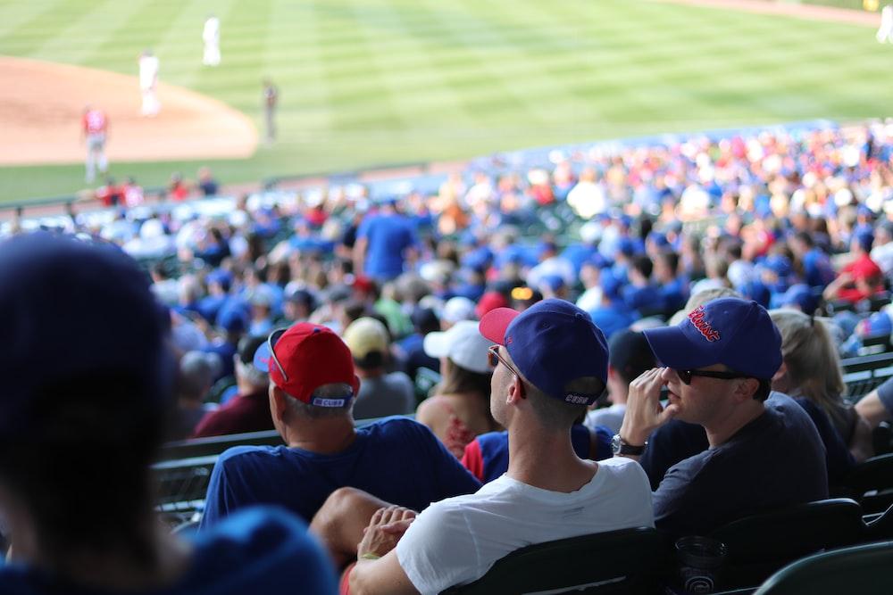 people sitting on stadium watching sports