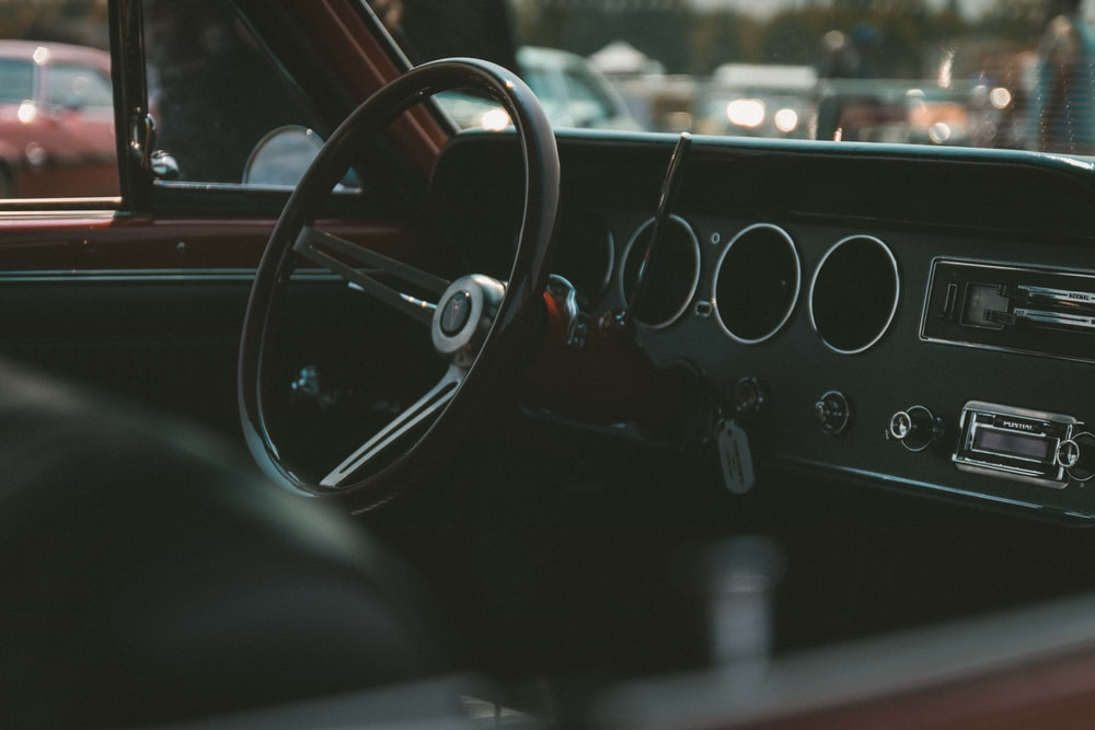 close-up photo of black vehicle steering wheel