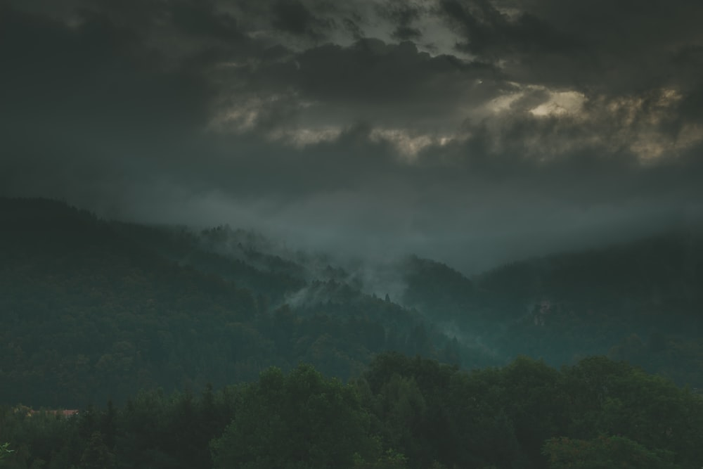 green mountains under gray clouds