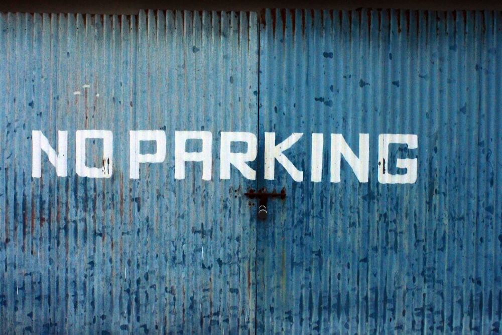 blue and white No Parking printed wall