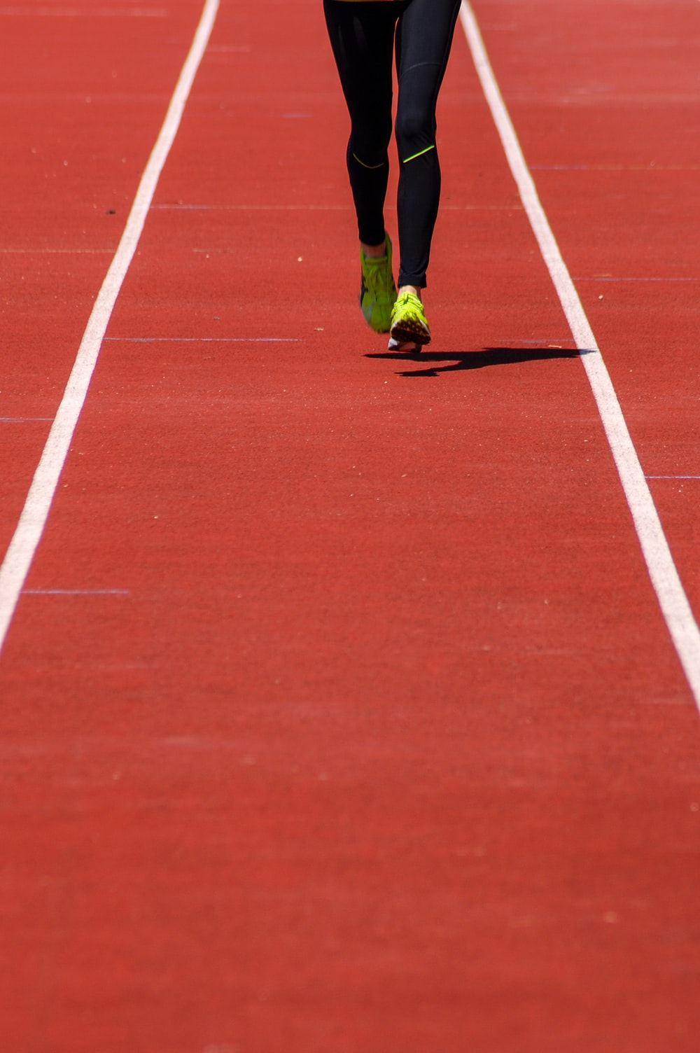 person running on track field