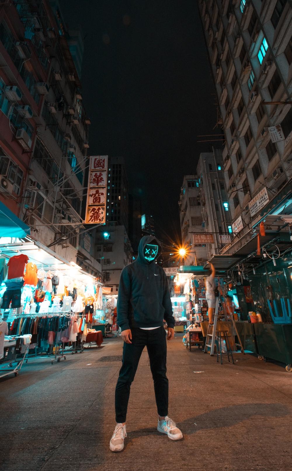 person in black hoodie standing