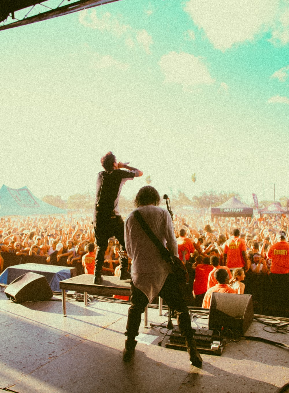 men performing at the stage in front of people during day