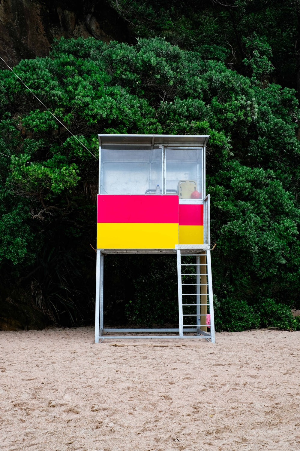 stainless steel lifeguard house beside green tree