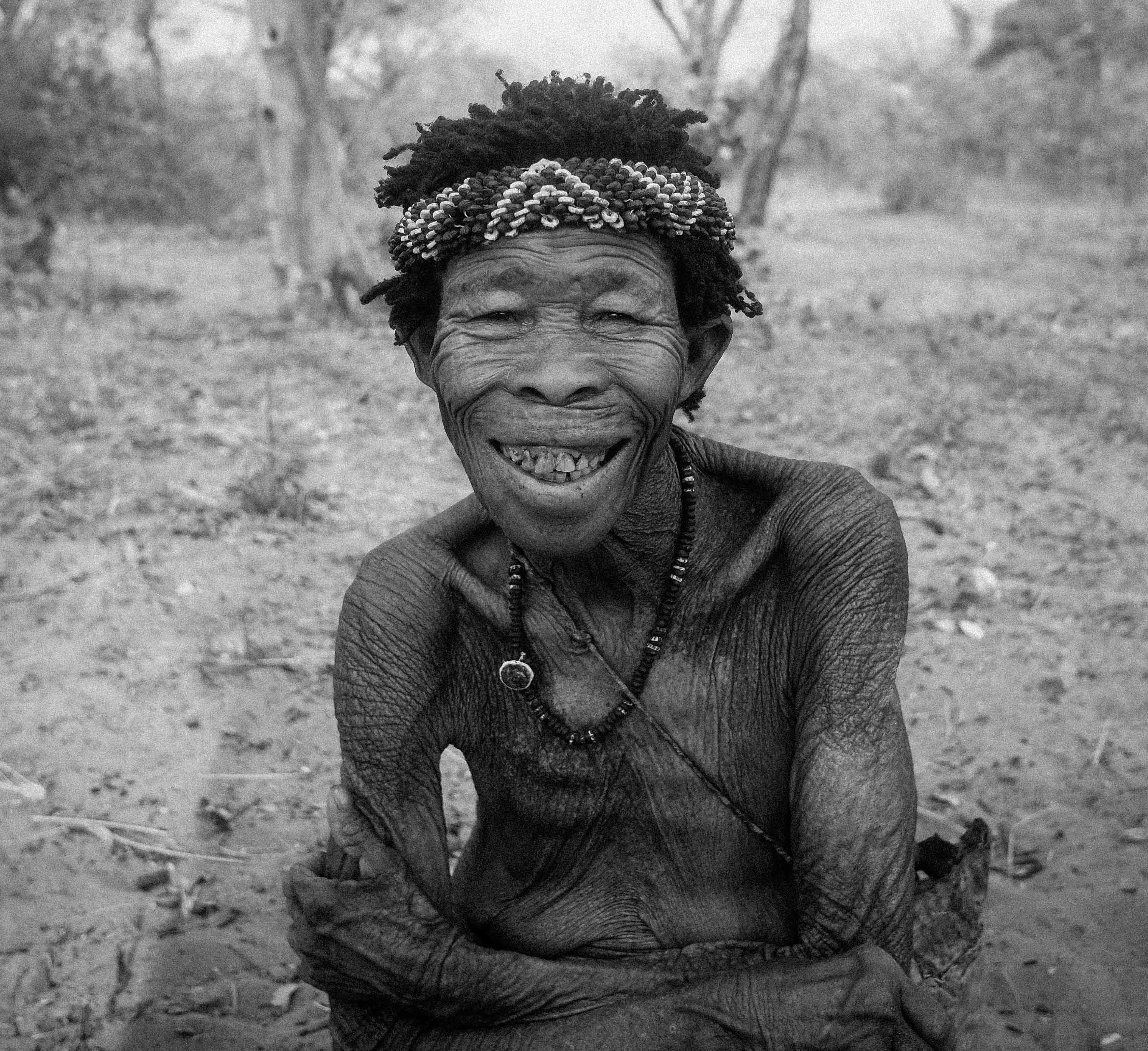 smiling man on grayscale photography