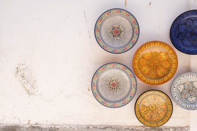 six assorted-color plate on white surface morocco zoom background