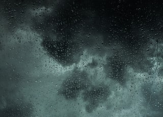 dew drops on glass panel