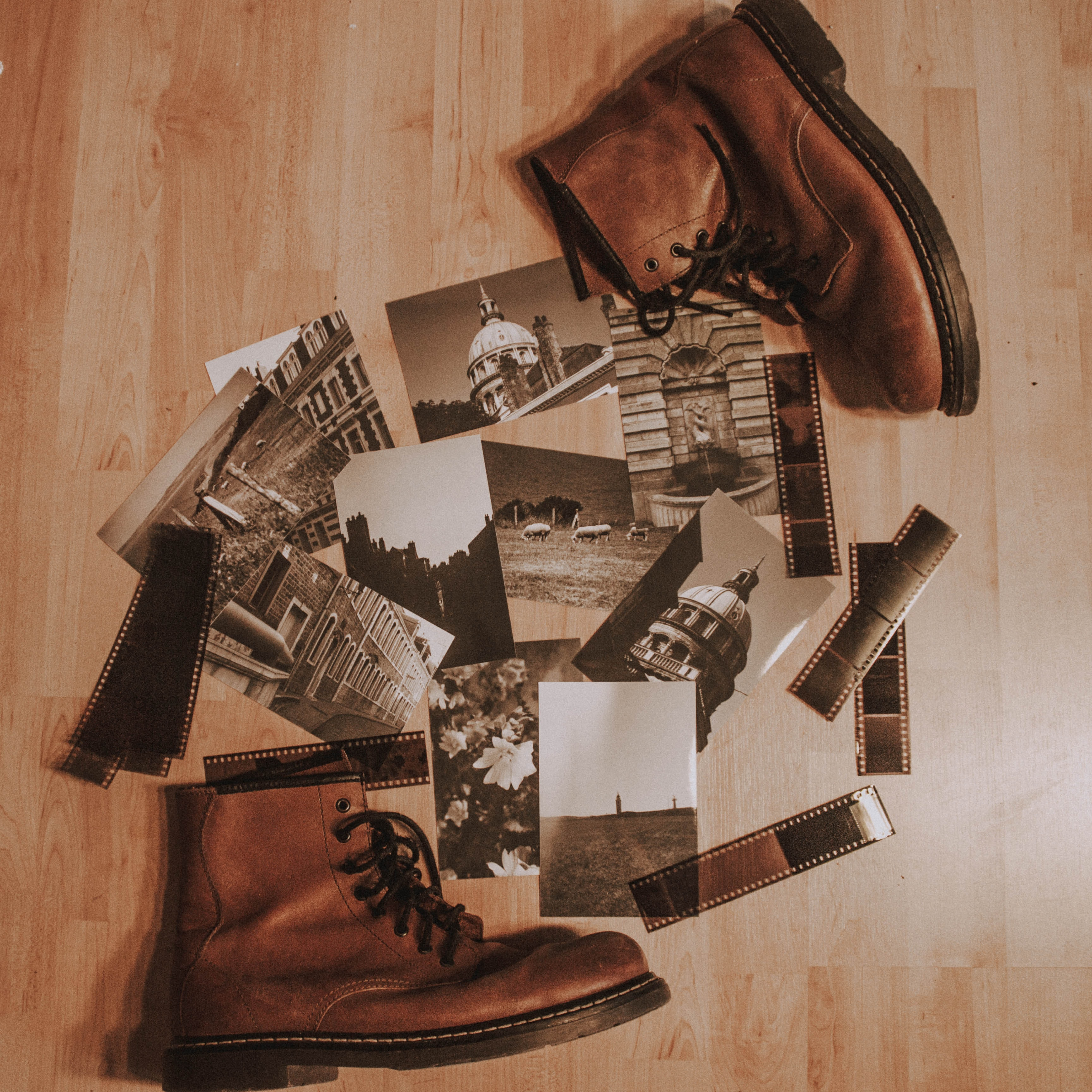 photos between pair of brown leather boots on floor