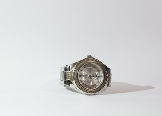 silver-colored watch with link bracelet