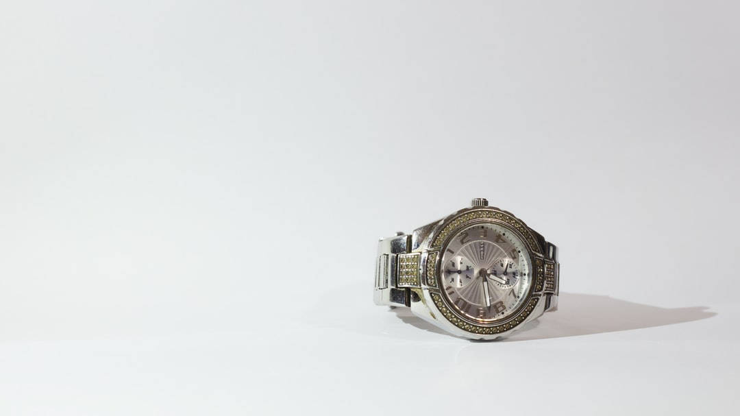My mom's watch came in as a challenging project that I gave myself. I made the white background out of white paper and used the flashlight on my phone with the normal lighting in the house (the shadow to the right was a result  of my phone's light). The image was taken at night.